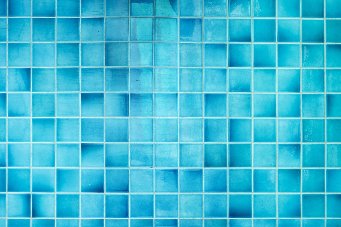 Picture of turquoise blue swimming pool tiles.